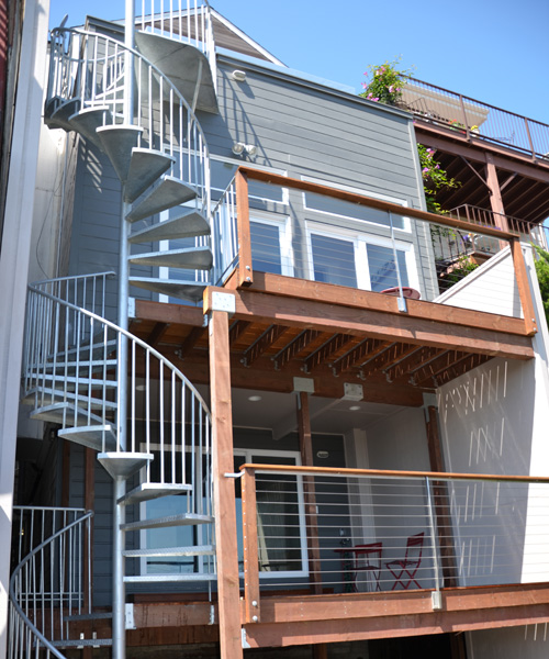 San francisco home exterior restoration and reconstruction for 2 story spiral staircase